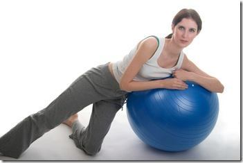Woman Leaning On Exercise Ball